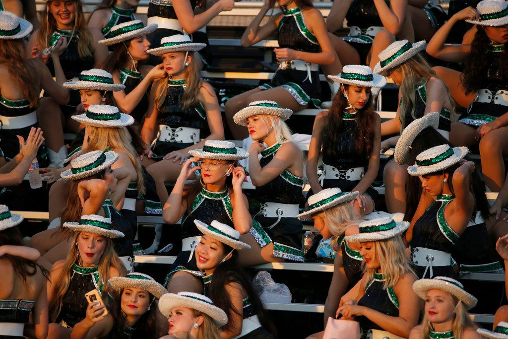 Southlake Emerald Belles drill team members prepare for their halftime performance their high school football game against South Grand Prairie in Southlake Texas on August 30, 2019. (Michael Ainsworth/Special Contributor)