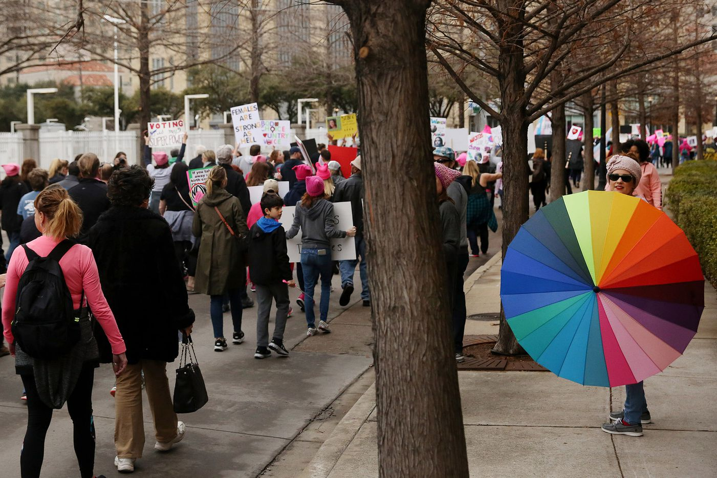 Marchers move Uptown during the Dallas Women's March in Dallas Saturday January 20, 2018. The march started at St. Paul United Methodist Church and ended at Pike Park in Uptown. Three marches took place in Dallas on Saturday, including the North Texas March for Life, Dallas Women's March and the Impeach Trump Solidarity Rally & March.