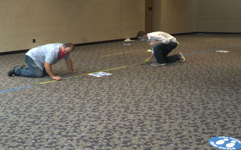 Workers are shown preparing the Richardson Civic Center for early voting in this still of a video shared by the city.