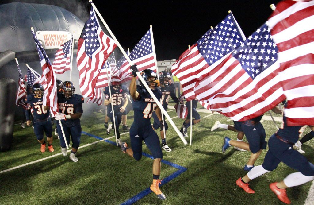 For Veteran's Day, every Sachse player, including James Ferris (45), carried an american flag on to the field during their runout before the start of a high school football playoff game against Skyline High on Friday, November 11, 2016. (John F. Rhodes / Special Contributor)