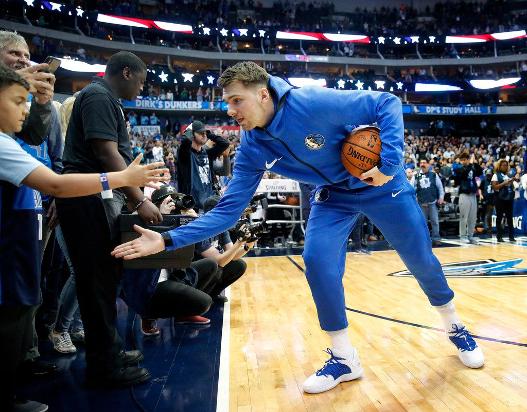 Dallas Mavericks forward Luka Doncic slaps hands with a young fan before his game against the Minnesota Timberwolves at the American Airlines Center in Dallas, Wednesday, April 3, 2019.