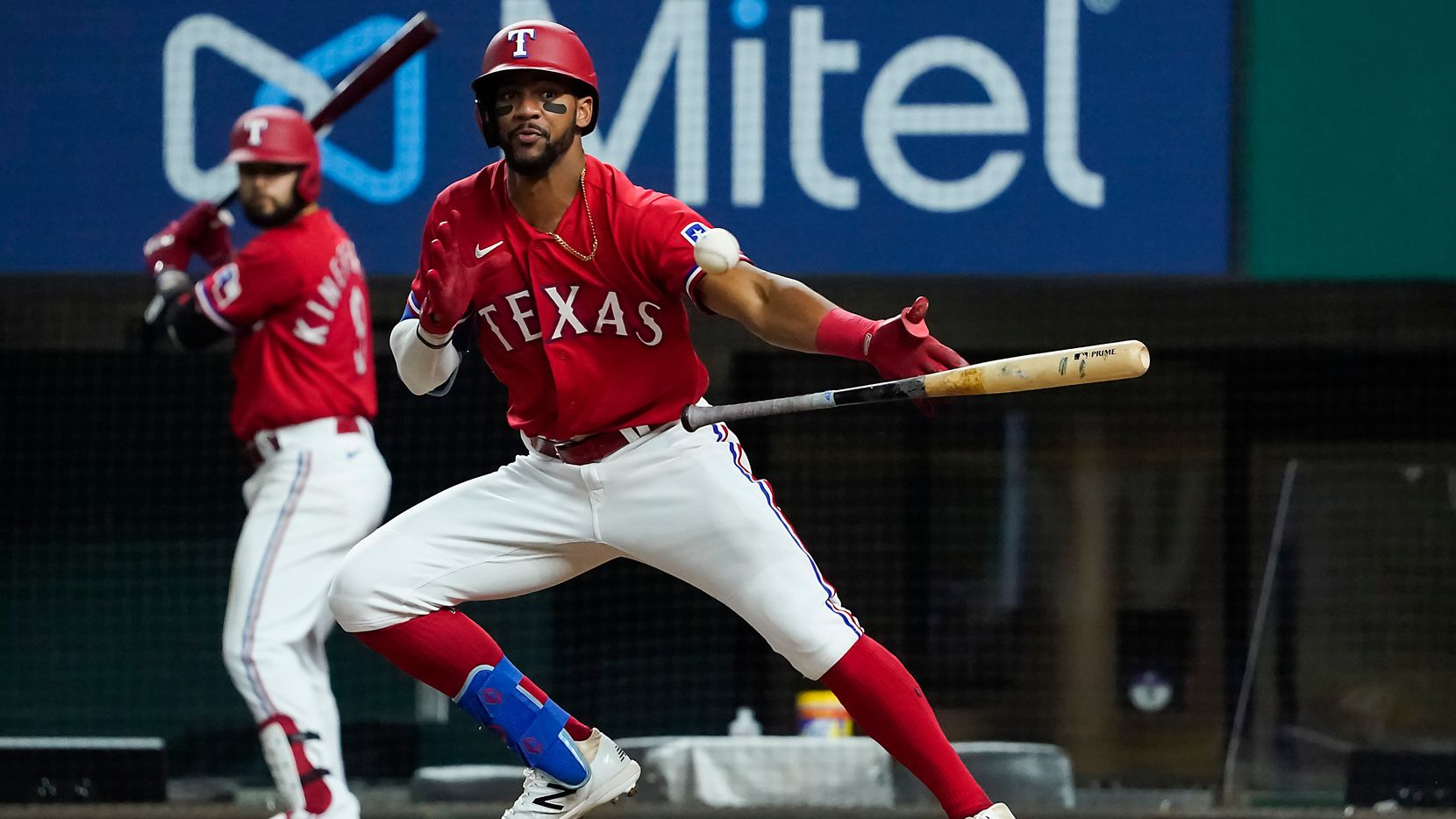 Texas Rangers center fielder Leody Taveras bunts the ball foul during the eighth inning against the Texas Rangers at Globe Life Field on Friday, April 16, 2021.