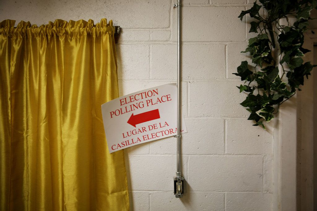 An election polling place sign hangs while setting up voting precinct 3045 at Gethsemane Missionary Baptist Church on Solar Lane in the Joppa neighborhood of Dallas before polls open on Election Day Tuesday November 8, 2016.