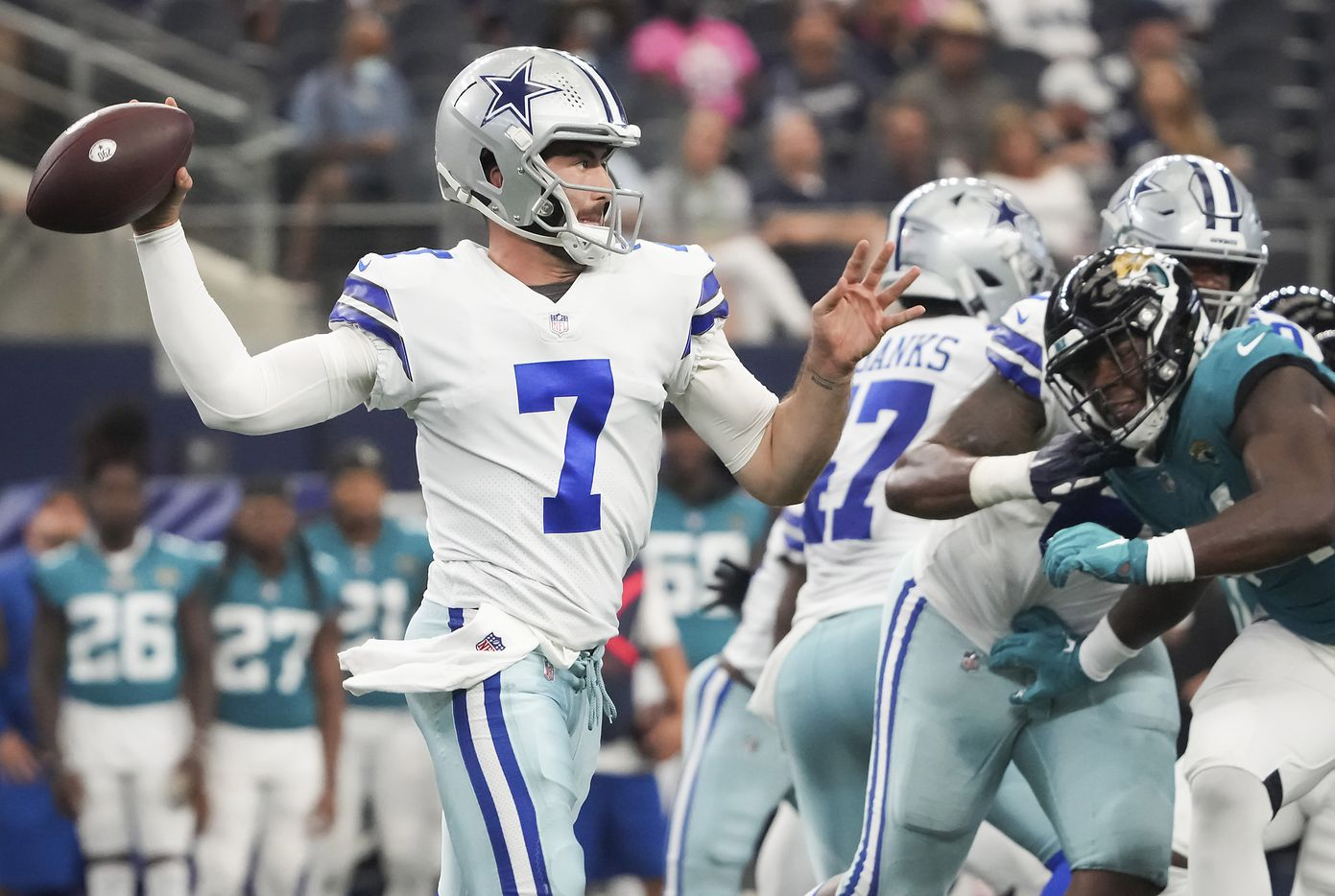 Dallas Cowboys quarterback Ben DiNucci (7) throws a pass during the second half of a preseason NFL football game against the Jacksonville Jaguars at AT&T Stadium on Sunday, Aug. 29, 2021, in Arlington. (Smiley N. Pool/The Dallas Morning News)