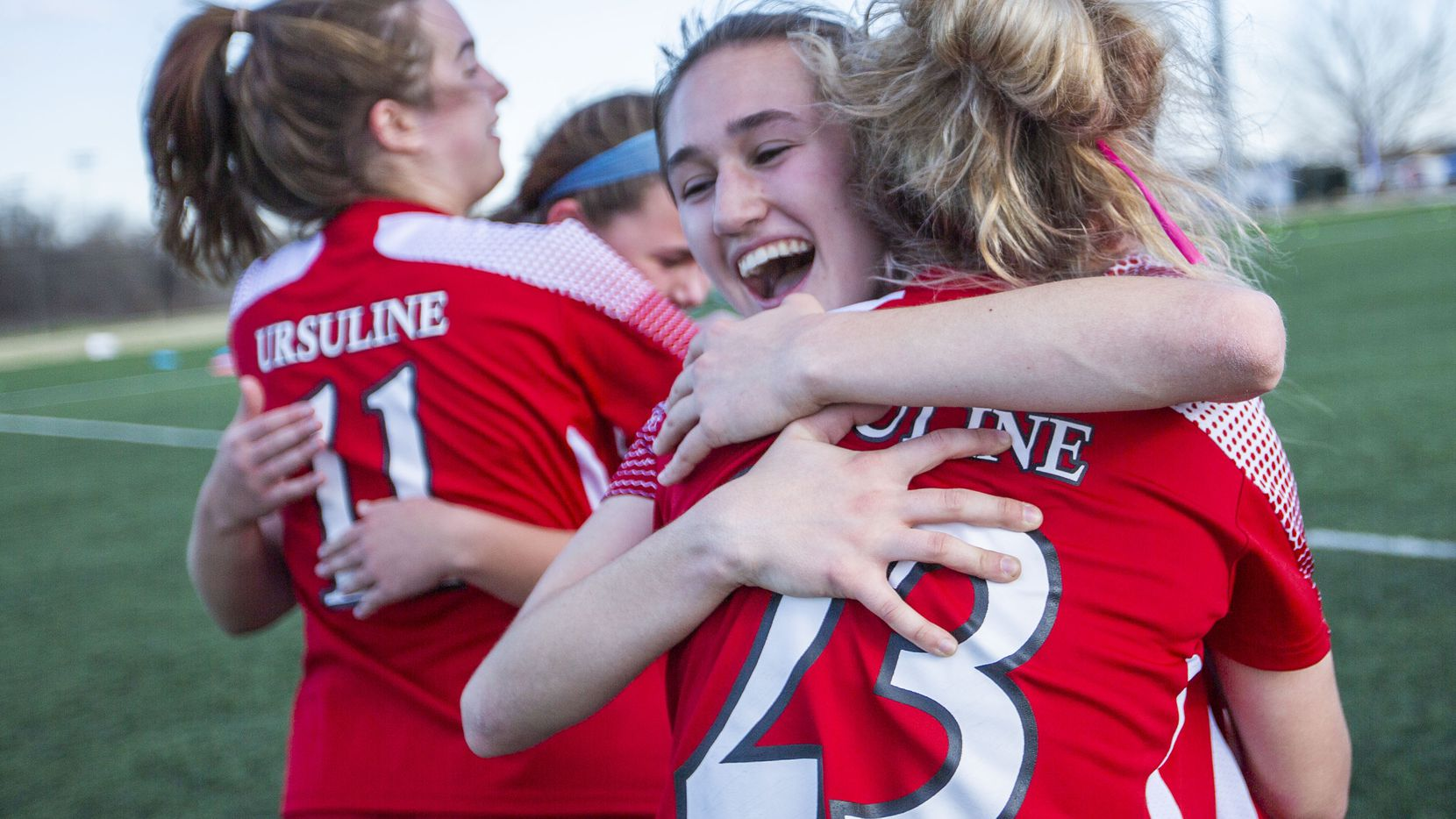 Ursuline's Bella Zanoni (3) hugs Juliet Moore (23) after their win against St. Agnes at their division 1 championship game at the Round Rock Multi Purpose Complex on March 5, 2021 in Round Rock, Texas. (Thao Nguyen/Special Contributor)