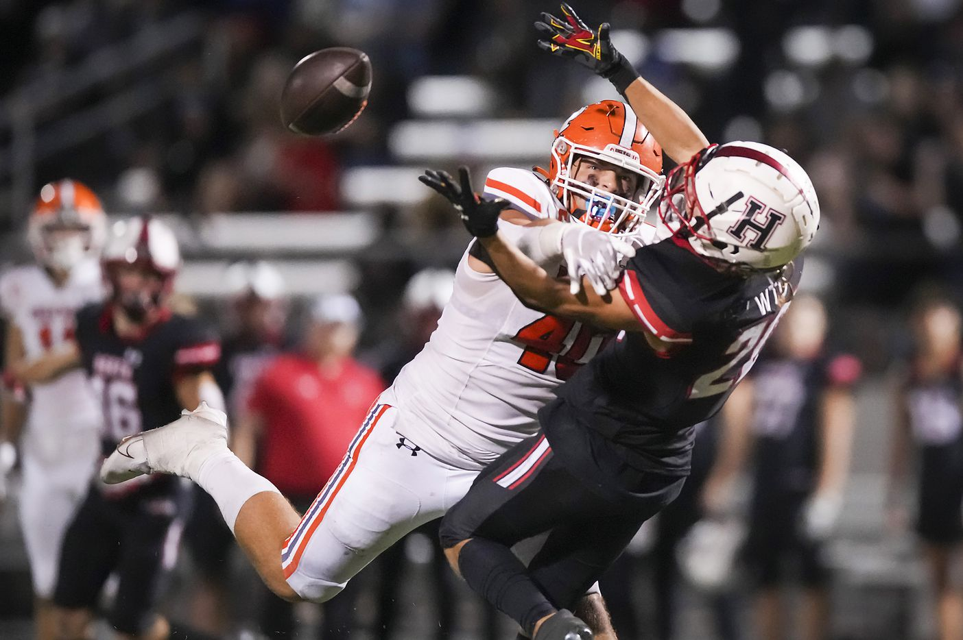 Heath defensive back Layne Horak (20) breaks up a pass intended for Rockwall tight end Brennan Ray (40) during the second half of a District 10-6A high school football game at Wilkerson-Sanders Stadium on Friday, Sept. 24, 2021, in Rockwall.  Rockwall-Heath won the game 79-71 in double overtime.