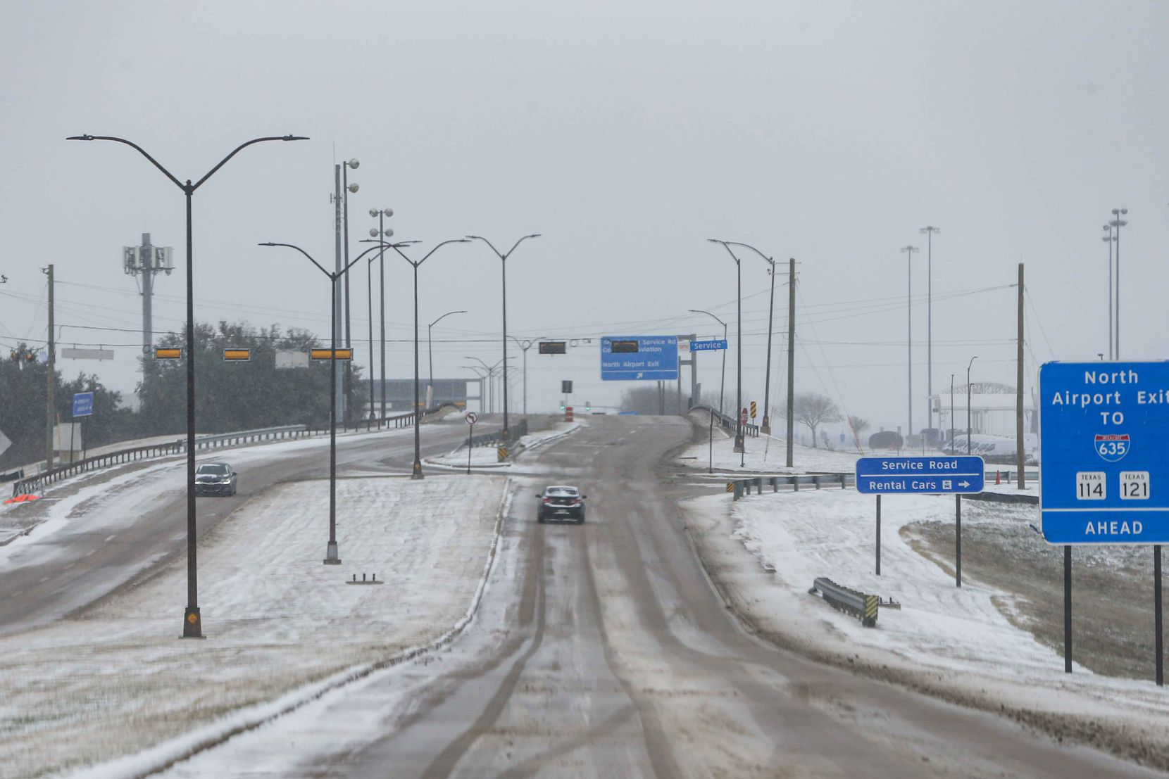 Snow and ice descend over DFW International Airport as American cancel hundreds of flights in Irving on Sunday, February 14, 2021.