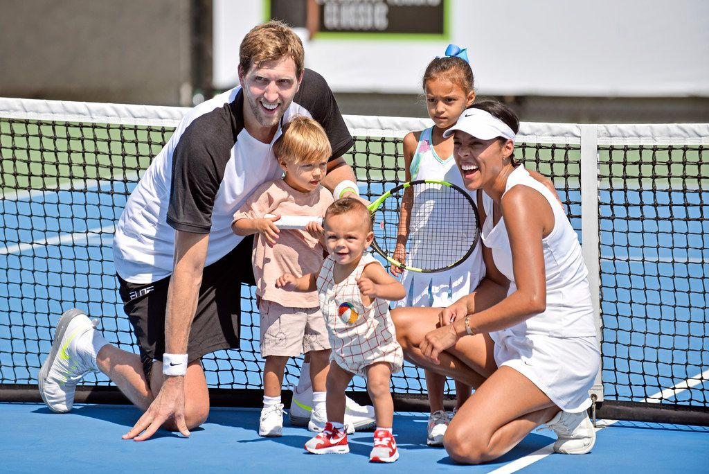FILE - Mavericks forward Dirk Nowitzki, left, and his wife, Jessica, are pictured with their children during the 2nd annual Dirk Nowitzki Pro Celebrity Tennis Classic at the SMU Tennis Center in Dallas on Saturday, Sept. 16, 2017. (Ben Torres/Special Contributor)