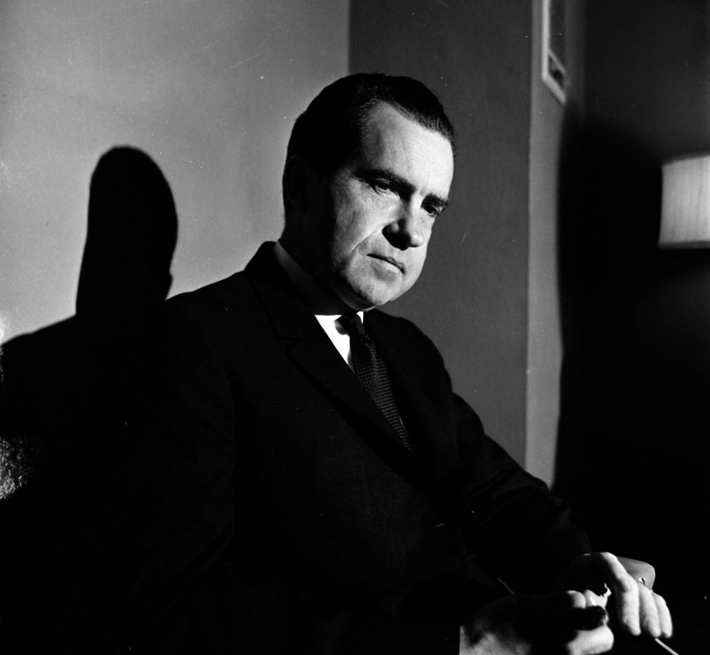 Former Vice-President Richard M. Nixon flew to Dallas Thursday, November 21, for a meeting of Pepsi-Cola bottlers.  HIs New York law firm represents the soft drink company.  Nixon answered questions and jabbed at the Kennedy administration during an informal press conference in his Baker Hotel suite.