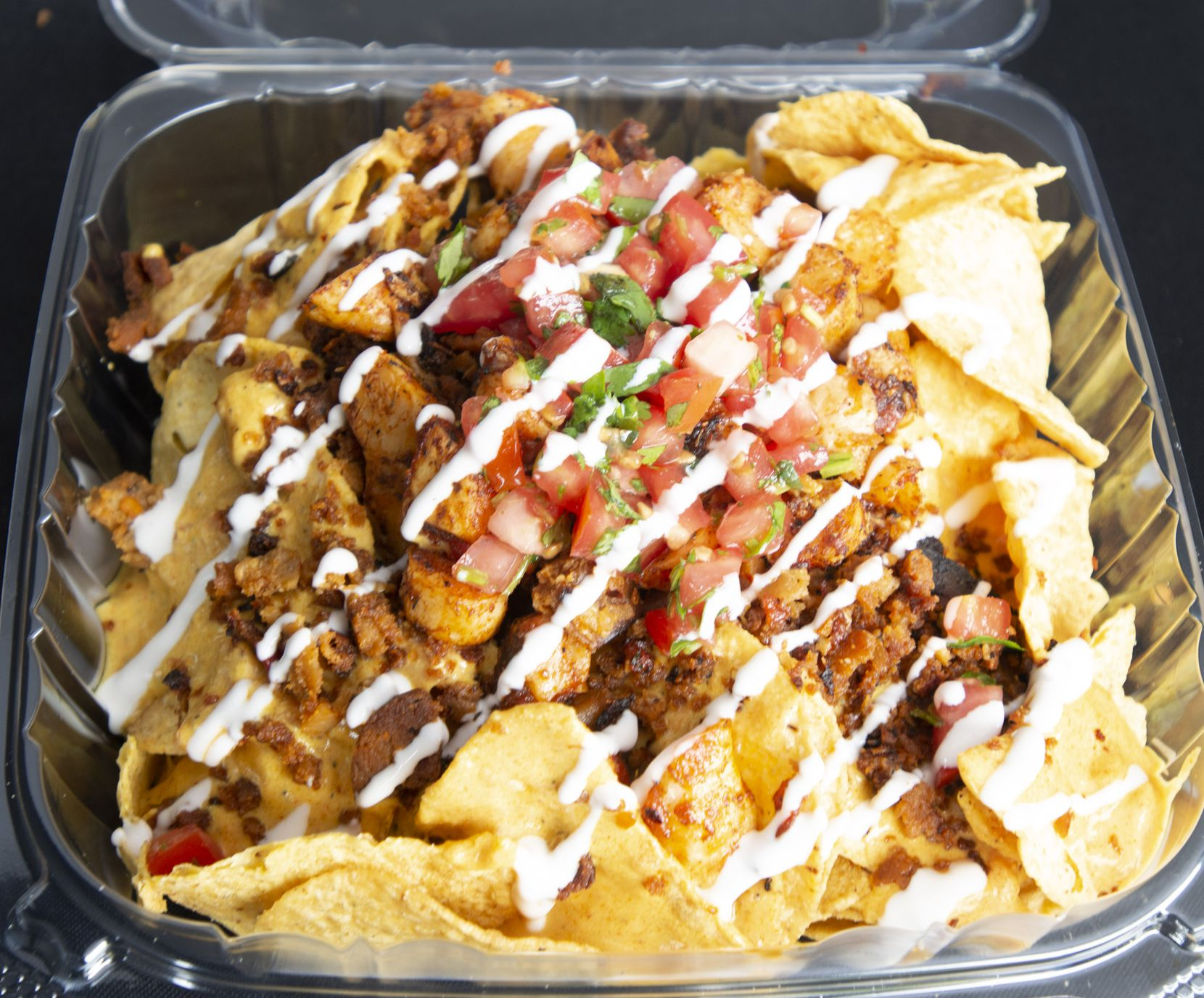 """Shrimp"" nachos at Brandon Waller's food stand in the Dallas Farmers Market on June 2, 2019. (Robert W. Hart/Special Contributor)"