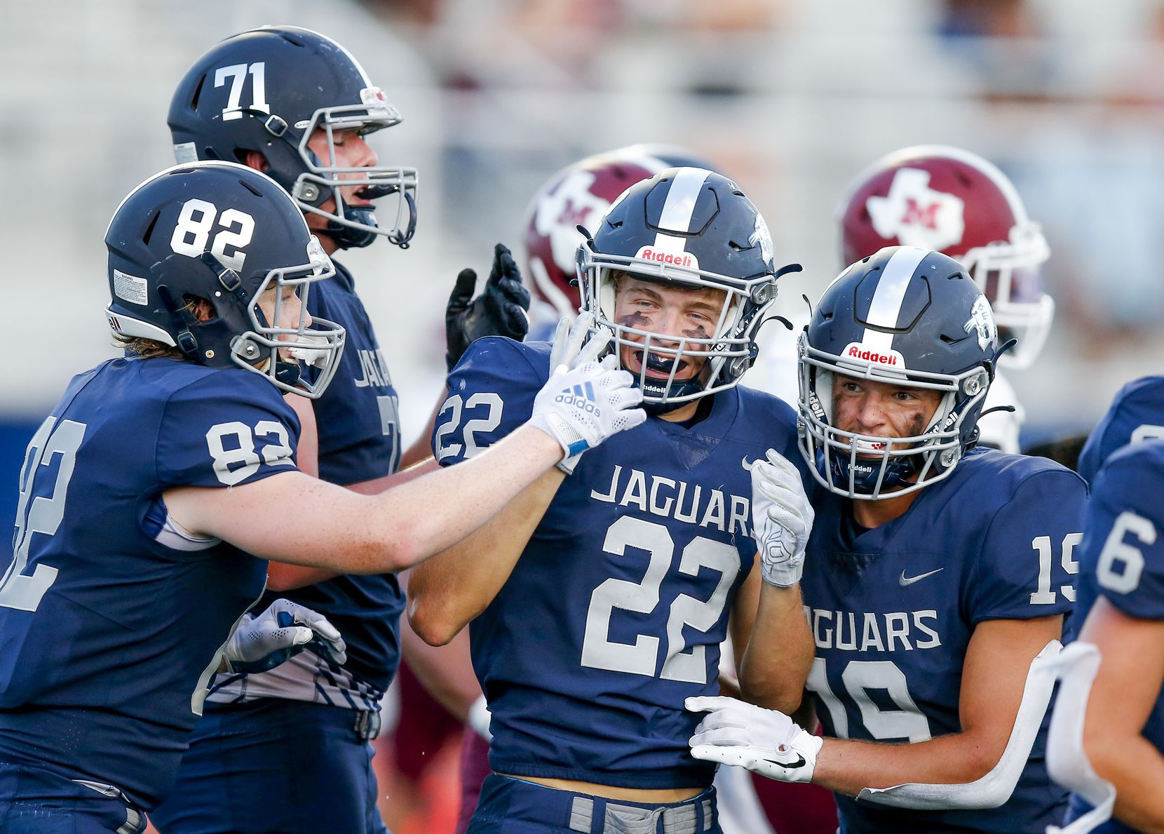 Flower Mound senior running back Cole Smith (22) is congratulated by teammates after scoring a touchdown during the first half of a high school football game against Mesquite at Flower Mound High School, Friday, August 27, 2021. (Brandon Wade/Special Contributor)