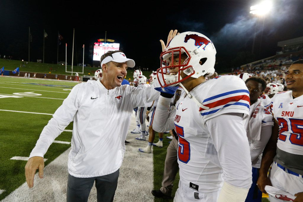 Southern Methodist Mustangs head coach Chad Morris congratulates Southern Methodist Mustangs defensive back Jordan Wyatt (15) after an interception to finish the game against Liberty Flames at Gerald J. Ford Stadium in Dallas, Texas on Saturday Sept. 17, 2016. SMU won the game 29-14. (Nathan Hunsinger/The Dallas Morning News)