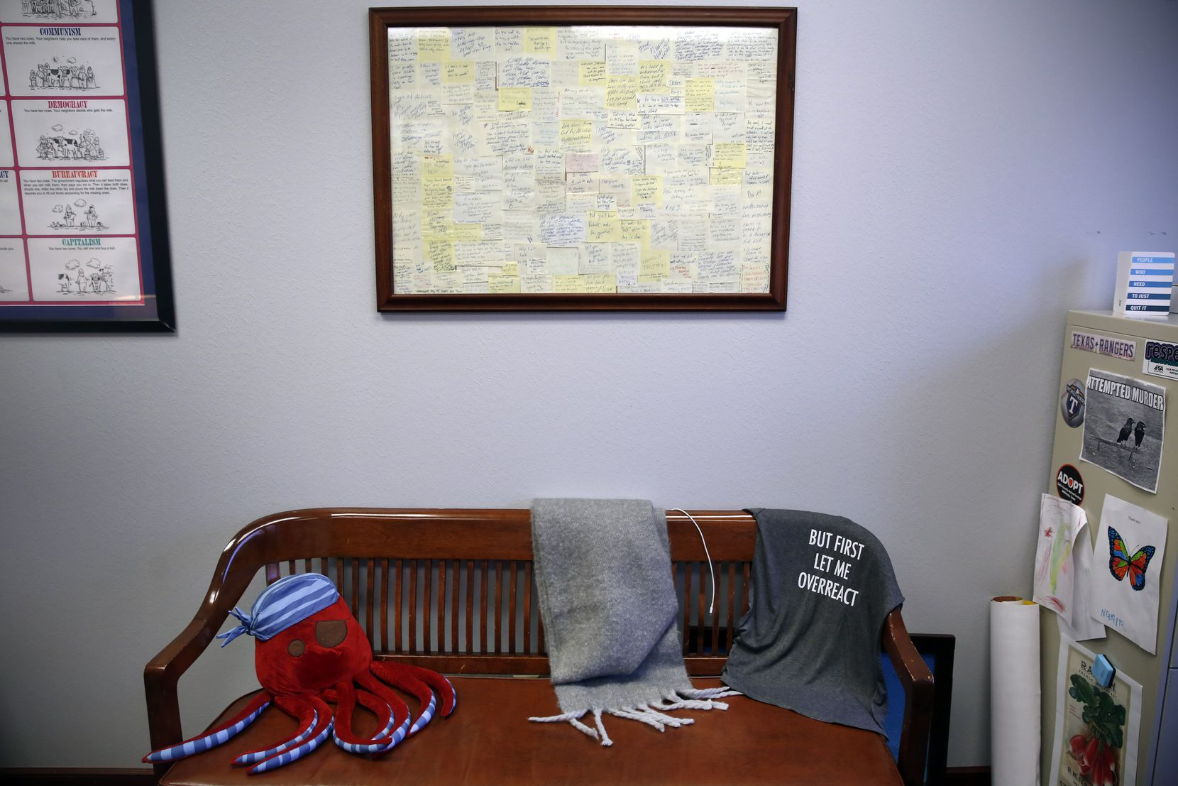 """Nicole Dana's office includes her """"therapy bench,"""" which she admits she took from another office """"by adverse possession"""" and which is regularly used by her colleagues seeking advice. The framed collection of Post-its are notes passed between Nicole and other prosecutors during her first big health-care fraud case."""