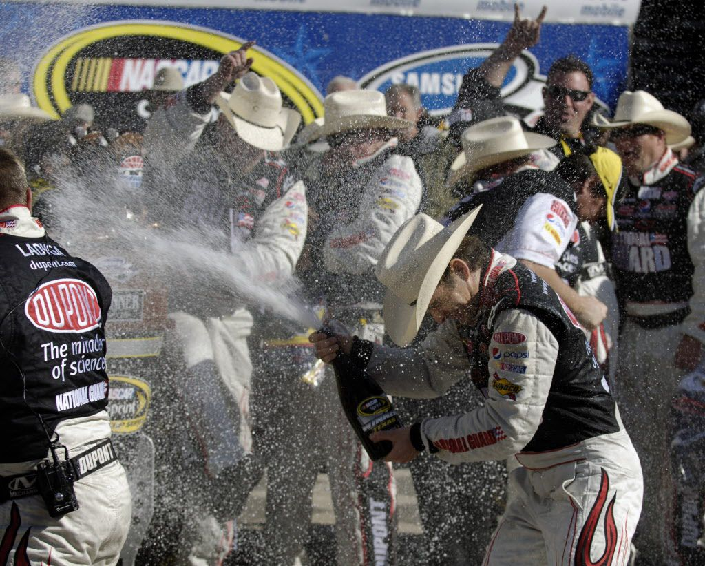 Jeff Gordon celebrates with his crewmen after winning the NASCAR Sprint Cup Series Samsung 500 at Texas Motor Speedway in Fort Worth, Texas,  on Sunday, April 05, 2009. It was Gordon's first win in Texas.