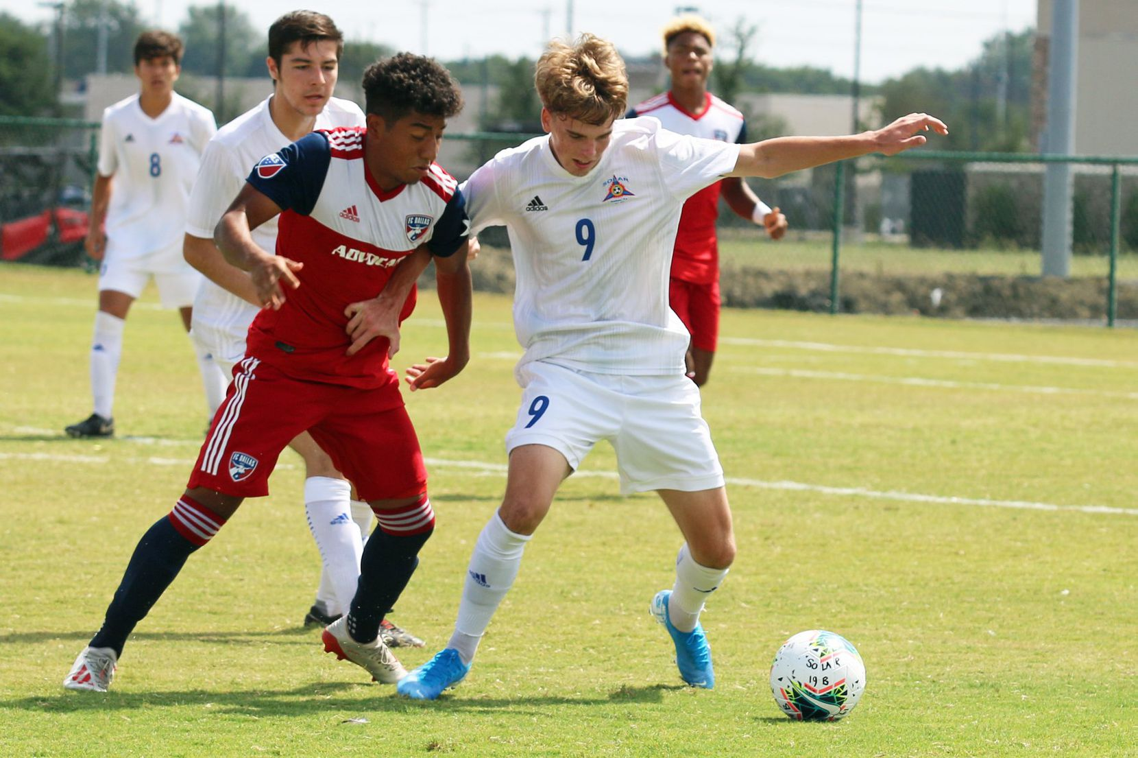 FC Dallas right back Kevin Bonilla defends against #9 Nathan Hayes of Solar SC. (9-22-19)