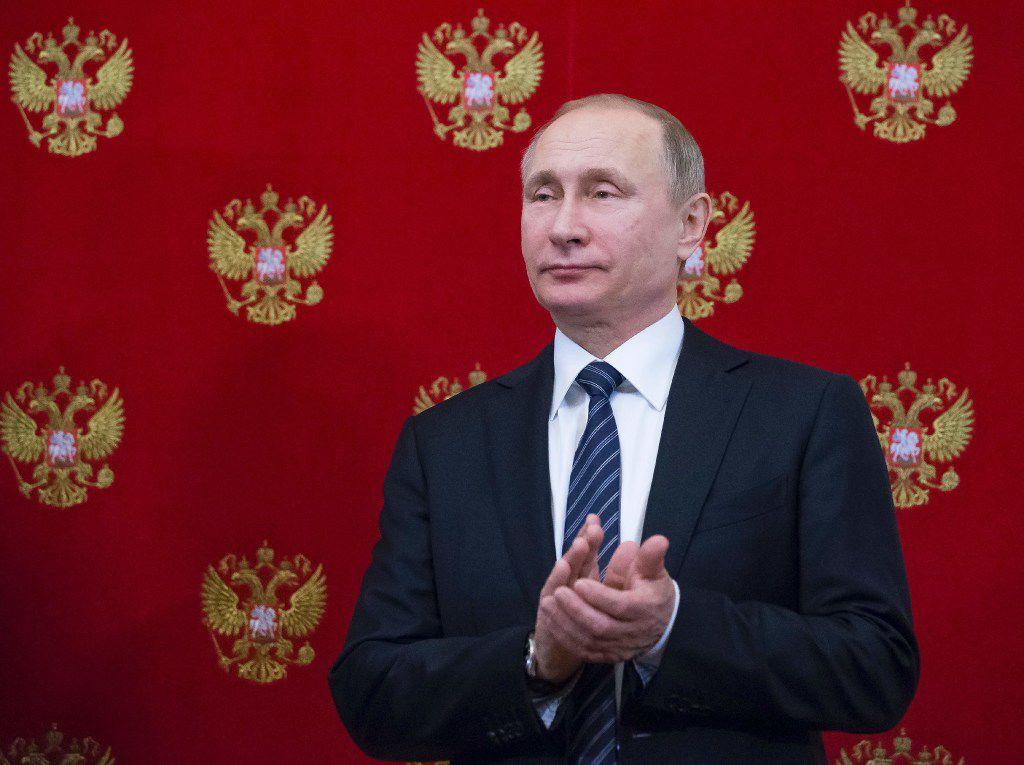 Russian President Vladimir Putin applauds during a signing ceremony on Feb. 10, 2017. (Alexander Zemlianichenko/Agence France-Presse)