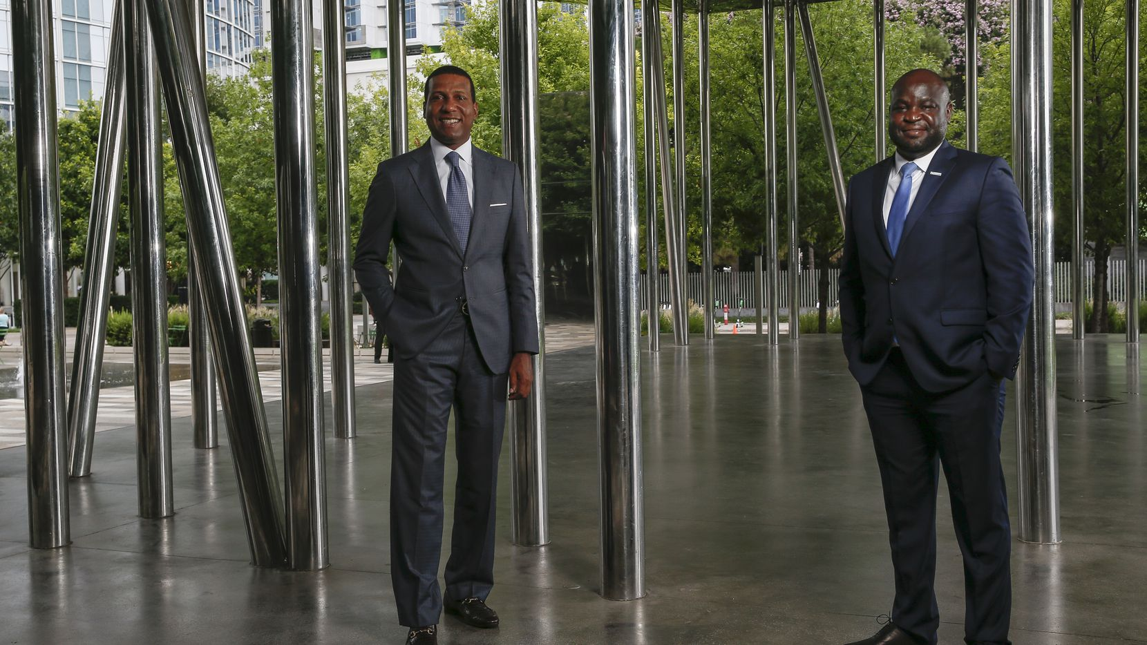 Fred Perpall (left), chairman of the Dallas Citizens Council and CEO of The Beck Group, and John Olajide, chairman of the Dallas Regional Chamber and CEO of Axxess, posed for a photograph on July 7 at Klyde Warren Park in Dallas.