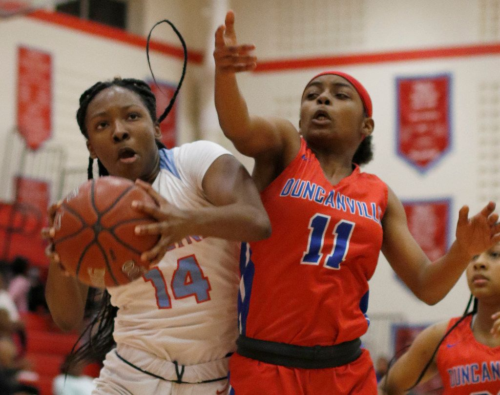 Dallas Skyline's Daryn Batts (14) pulls down a defensive rebound as she is challenged by Duncanville's Tristen Taylor (11) during first half action. The two teams played their girls basketball game at  Skyline High School in Dallas on January 7, 2020. (Steve Hamm/ Special Contributor)