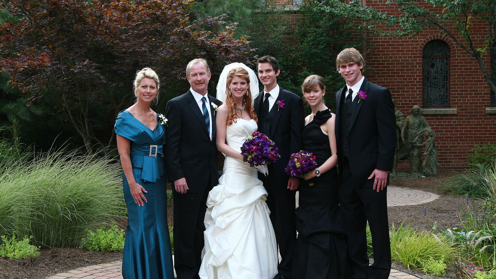 Taken in July 2010, at daughter Jenna's wedding. From left to right, it's Bekki Nill, Jim Nill, Jenna, son-in-law Zack, daughter Kristin and son Trevor. Jenna is 26, Kristin 20 and Trevor 22. Trevor played hockey at Michigan State for four seasons
