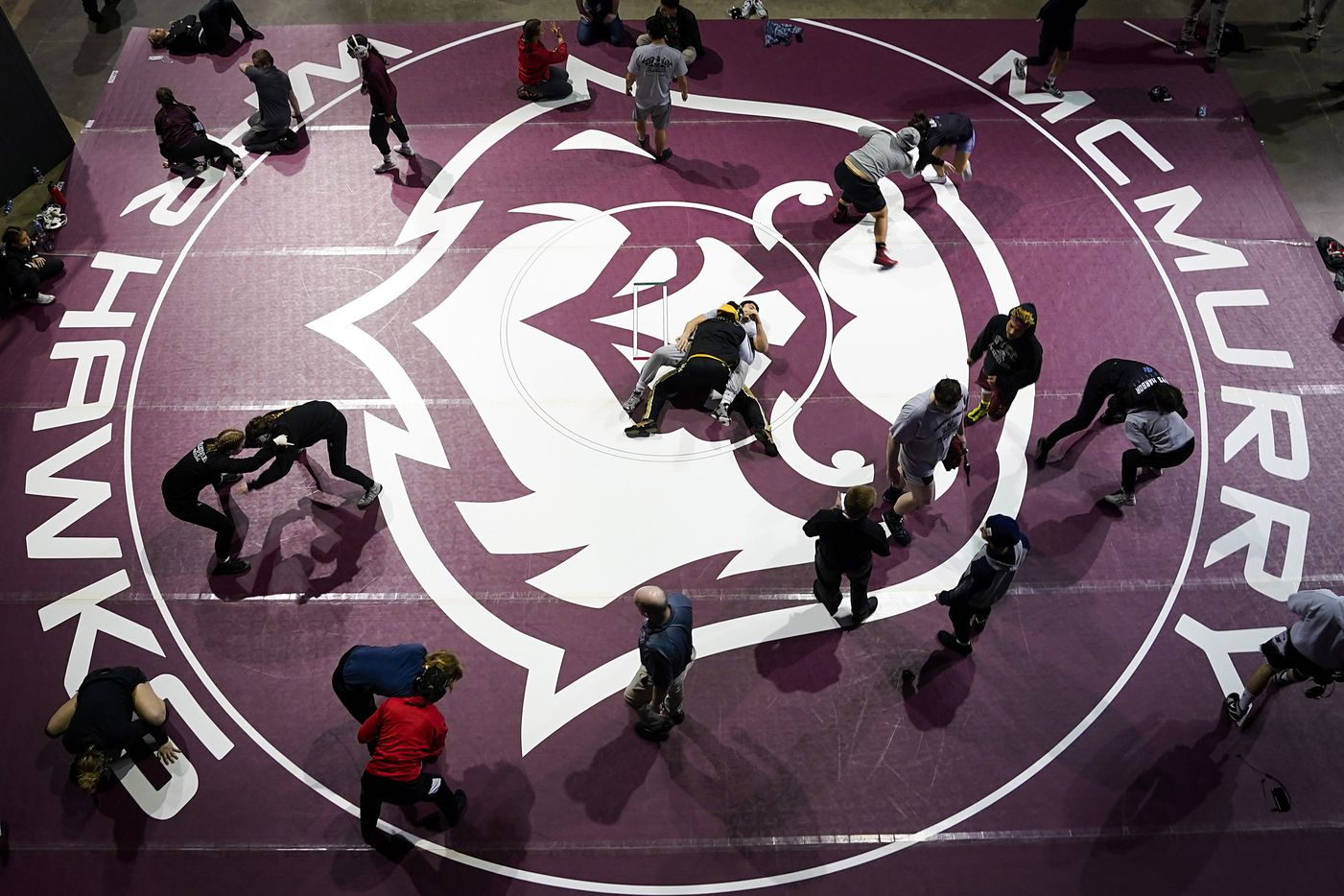 Wrestlers warm up before competing in the semifinals of the NCWA national championships at the Allen Events Center on Friday, March 13, 2020, in Allen, Texas.
