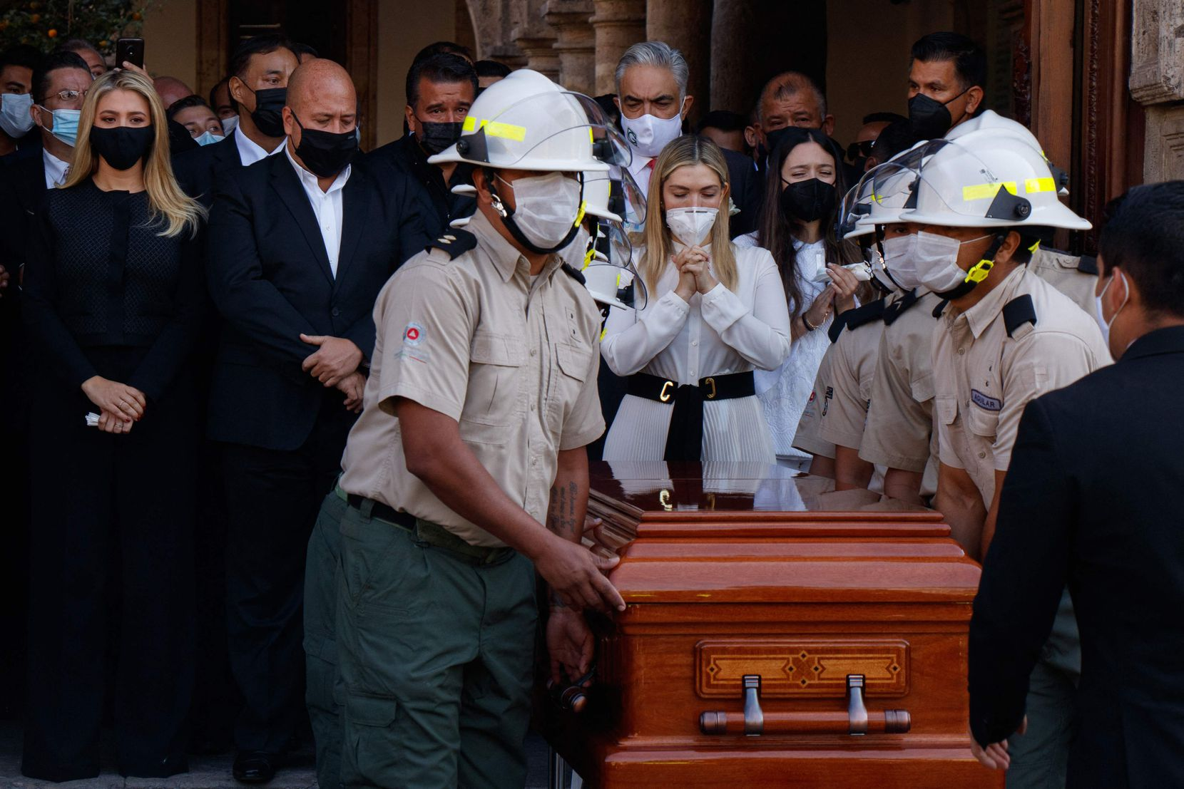 Relatives of the former Jalisco governor Aristoteles Sandoval, murdered in Puerto Vallarta, walk next to his coffin on the way to the Government Palace for a tribute, in Guadalajara, state of Jalisco, Mexico, on December 19, 2020.