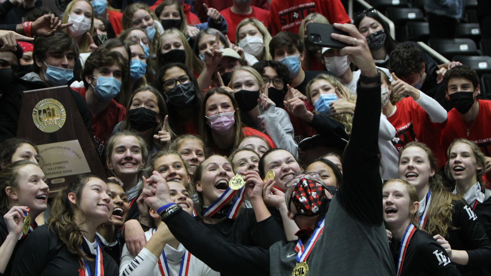 What better time to pause for a group selfy as the Lovejoy players celebrate with the student section of fans following their state championship victory over Lamar Fulshear in straight sets. The two teams played their Class 5A state championship volleyball match at Curtis Culwell Center in Garland on December 12, 2020. (Steve Hamm/ Special Contributor)