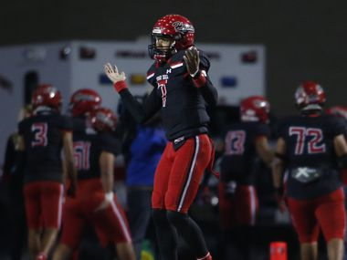 Cedar Hill quarterback Kaidon Salters (7) gestures toward the DeSoto team bench area after combating a strong DeSoto blitz with a touchdown pass during the first quarter of play. The two teams played their District 11-6A  football game at Longhorn Stadium in Cedar Hill on November 6, 2020.