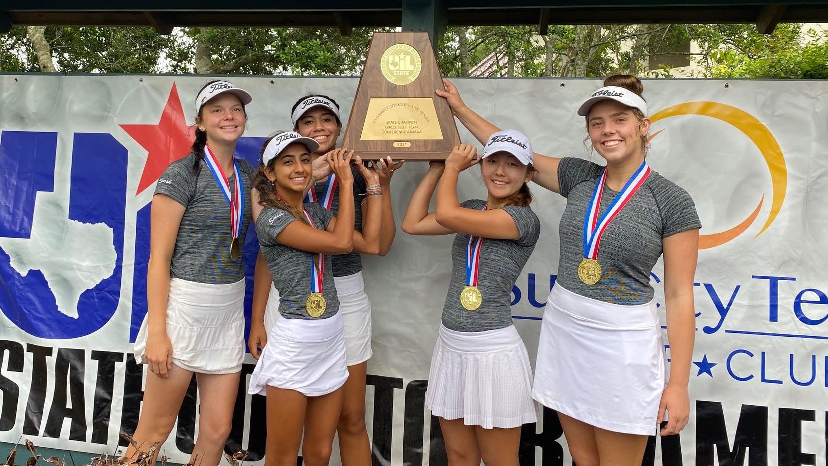 The Hebron High School girls golf team poses with the 2021 UIL Class 6A State Championship trophy.