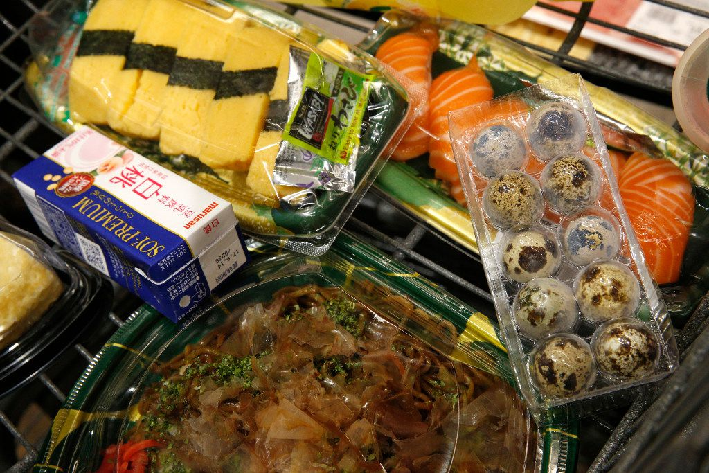 A shopping cart filled with goodies at Mitsuwa Marketplace in Plano