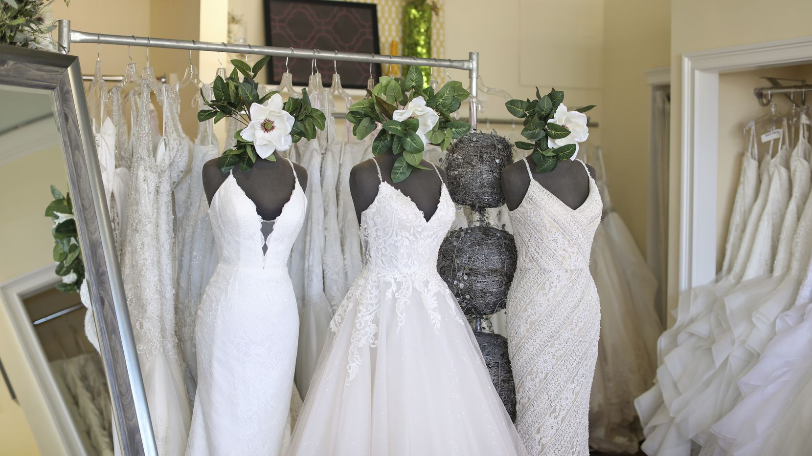 Wedding dresses are displayed at Complete Bridal, a shop in East Dundee, Ill.