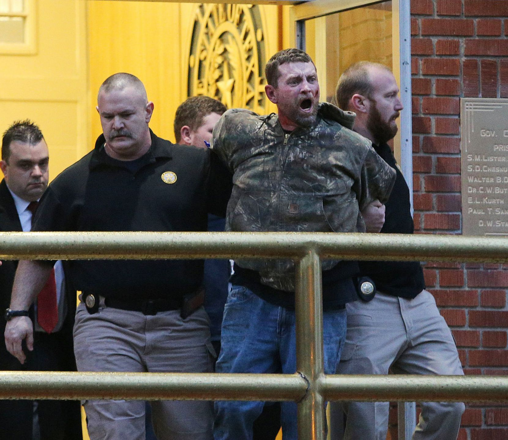 Gordon Coble was led out of Huntsville state prison Thursday after authorities say he went berserk during the execution of his father, Billie Wayne Coble. (Jerry Larson/Waco Tribune-Herald via AP)