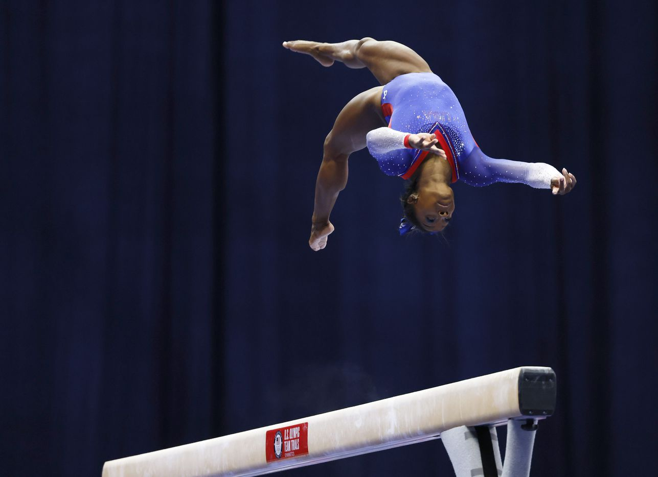 Simone Biles of World Champions competes on the balance beam during day 1 of the women's 2021 U.S. Olympic Trials at America's Center on Friday, June 25, 2021 in St Louis, Missouri.(Vernon Bryant/The Dallas Morning News)