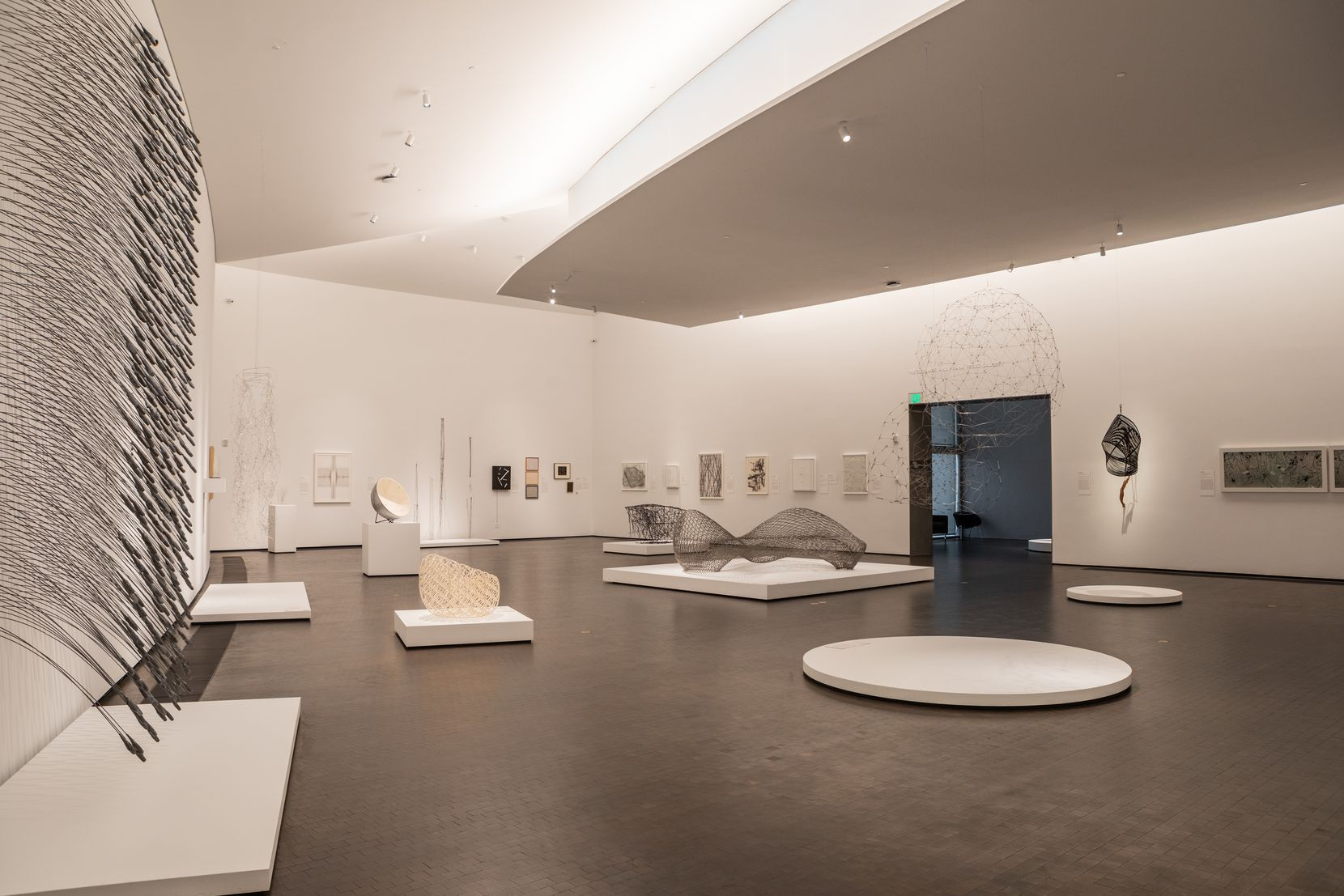 Within the galleries, light is controlled from above, pricking out of flanges in the ceiling.