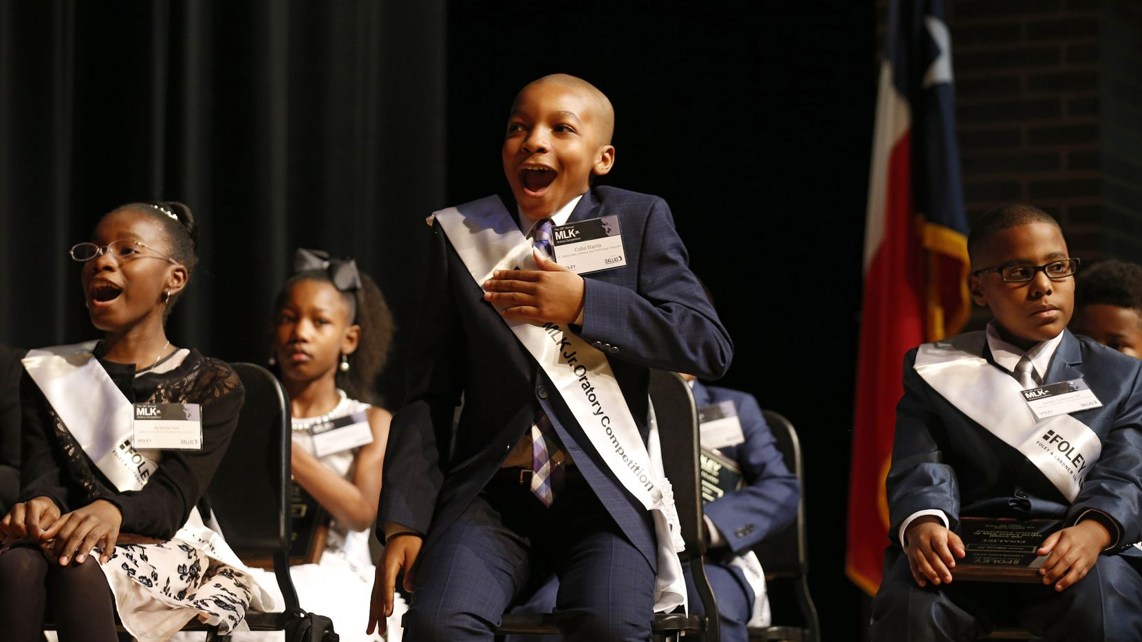 """Colin Harris of J.P. Starks Math, Science and Technology Vanguard reacts after his name is called to receive the first place award during the 28th annual MLK Jr. Oratory Competition at W.H. Adamson High School in Dallas on Friday, January 17, 2020. Eight students presented 3-5 minute speeches about the topic, """"What Would Dr. King's vision be for America in 2020."""""""