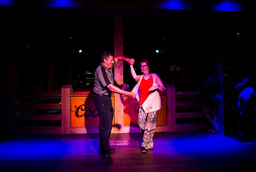 Bill McKenzie and Dolly Franco dance at PBR Texas during the grand opening celebration for Texas Live.