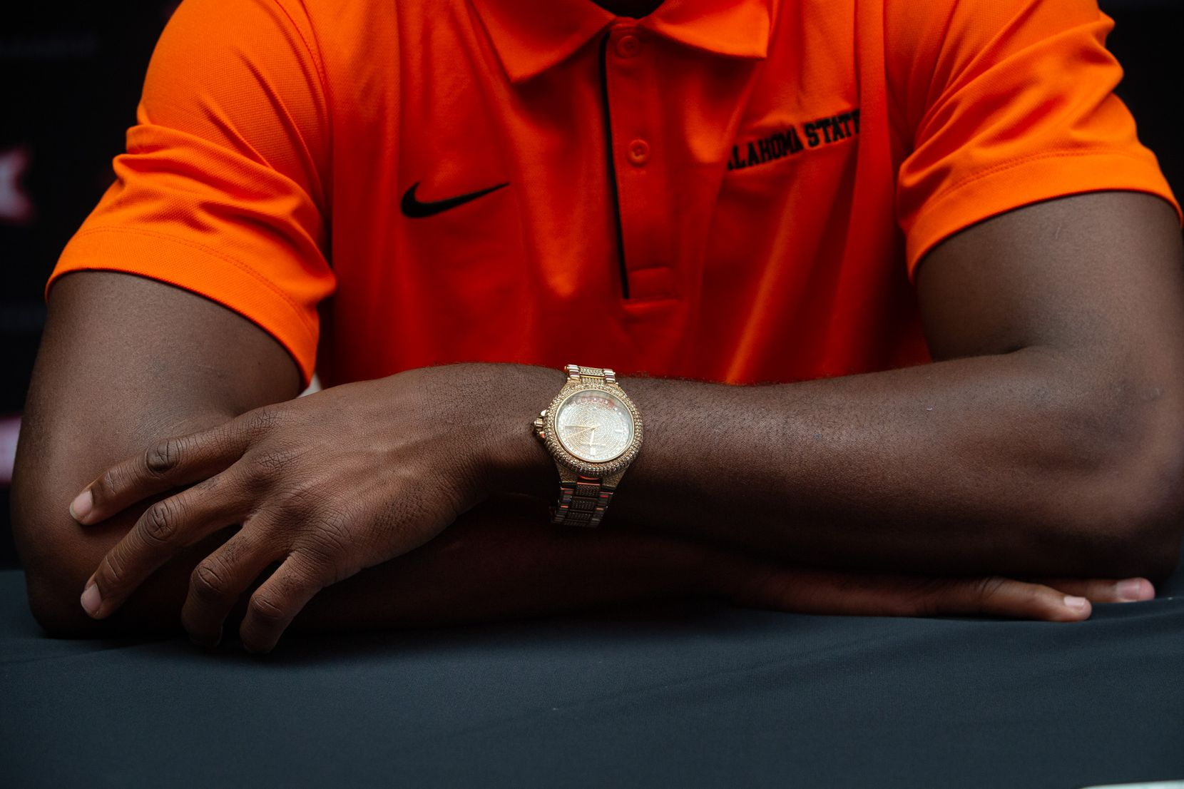 Oklahoma State University football cornerback A.J. Green wears a Michael Kors watch during the Big 12 Conference Media Days.
