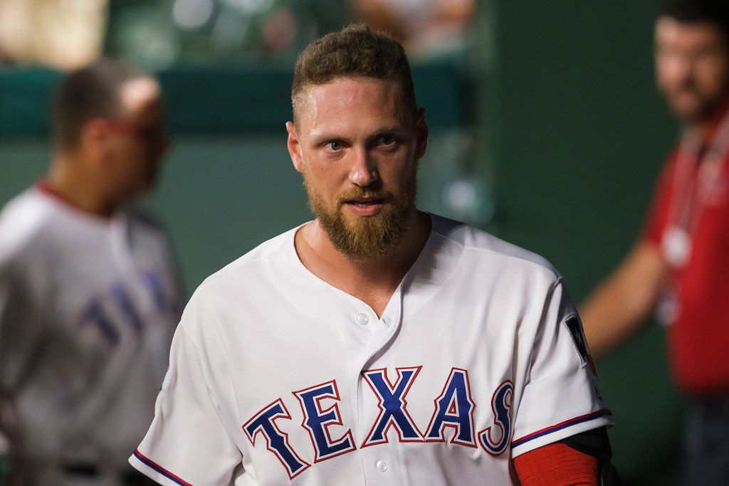 FILE - Rangers pinch hitter Hunter Pence is pictured in the dugout after batting in the eighth inning of a game against the Seattle Mariners at Globe Life Park on Tuesday, July 30, 2019, in Arlington.