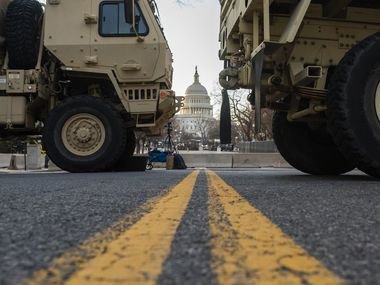 National Guard troops block traffic near the U.S. Capitol on January 19, 2021. Tens of thousands of troops were deployed as additional security for President-elect Joe Biden's inauguration following the January 6 attack on the U.S. Capitol.