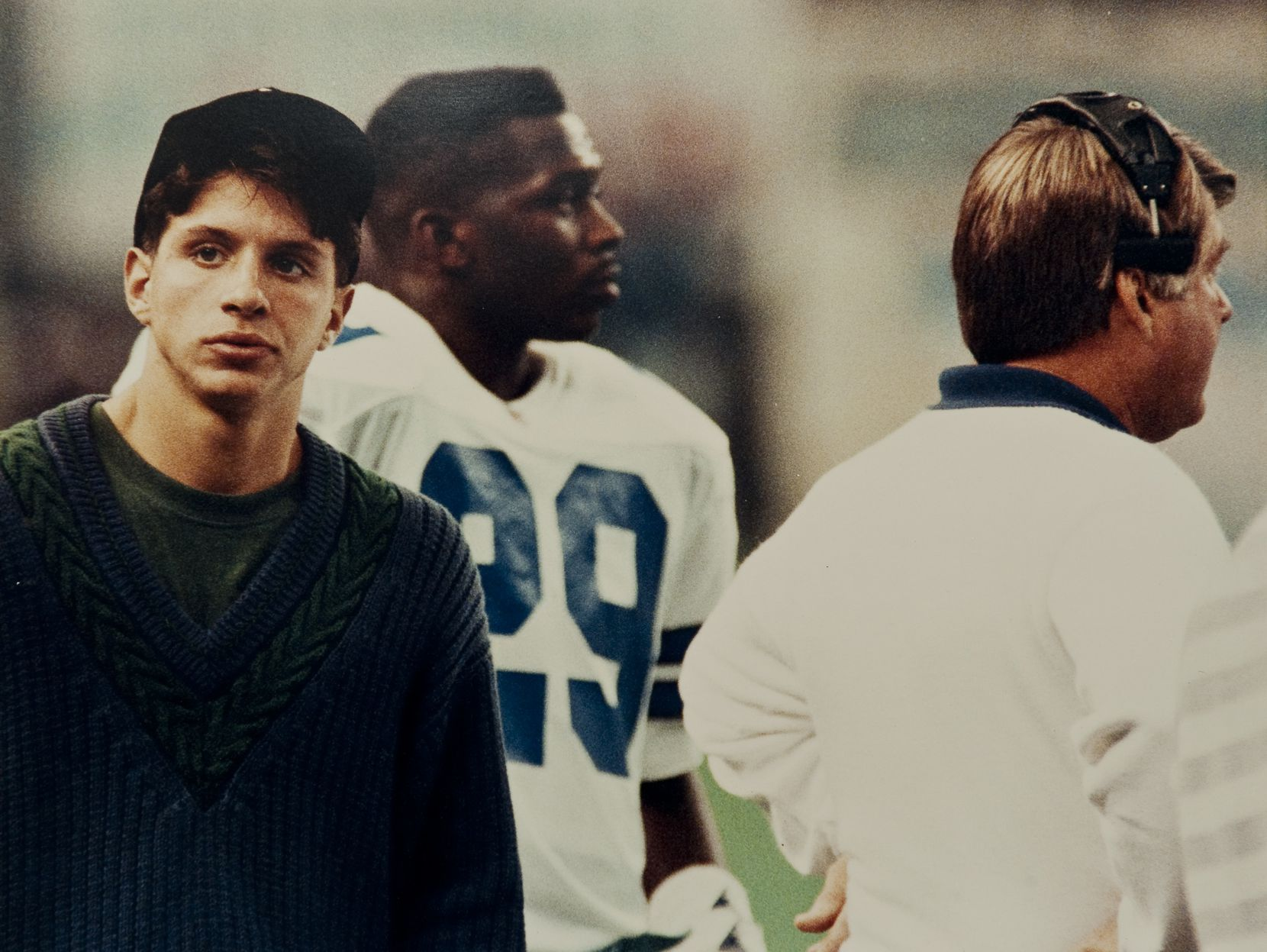 A copy photograph of Damon West (left) standing on the sidelines with the Dallas Cowboys' Kenny Gant (center) and Jimmy Johnson (right) during the Cowboys' game against the Houston Oilers on Nov. 10, 1991, in the Astrodome in Houston.