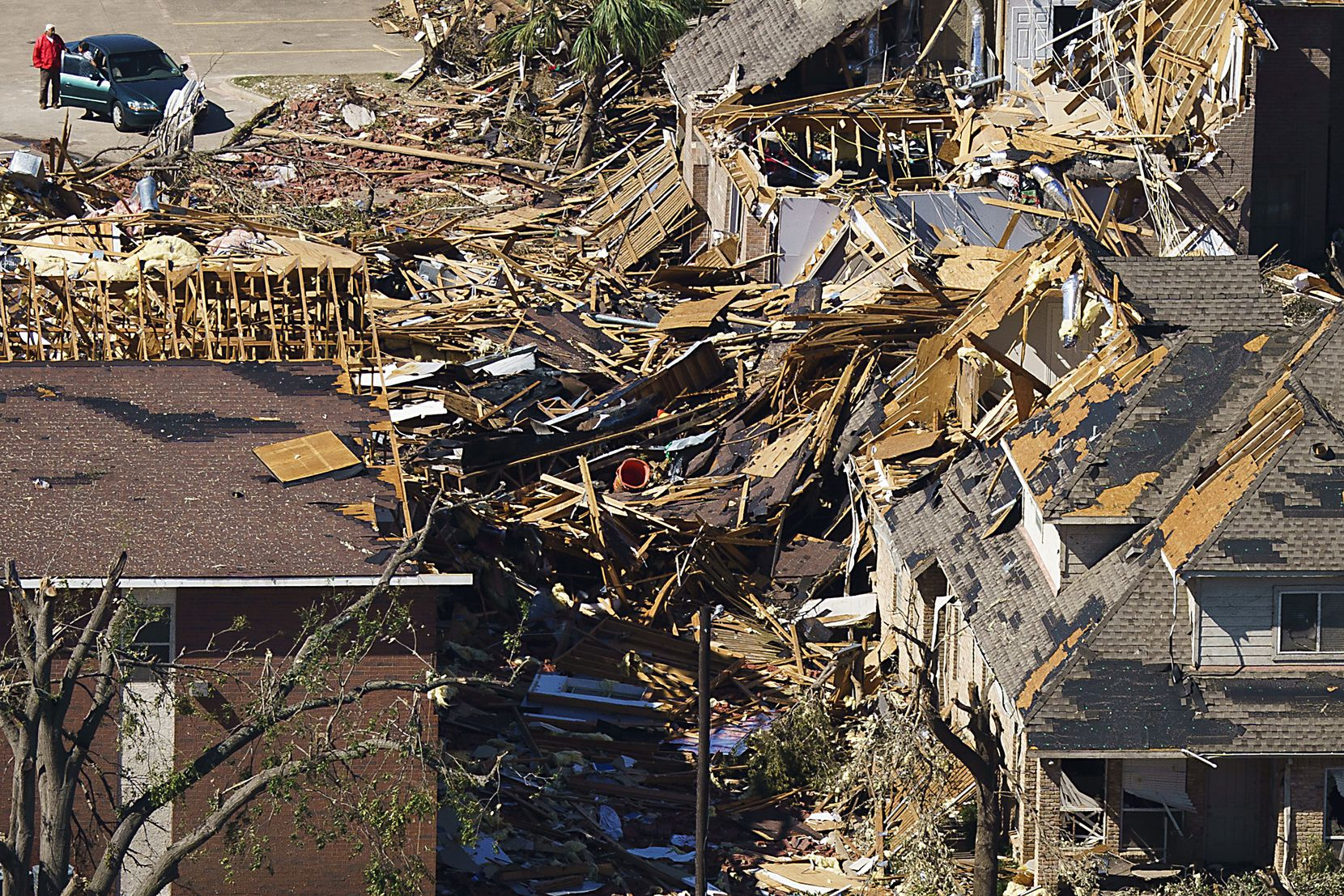 Damaged homes near Walnut Hill and Marsh Lane are seen in aerial view of tornado damage on Monday.