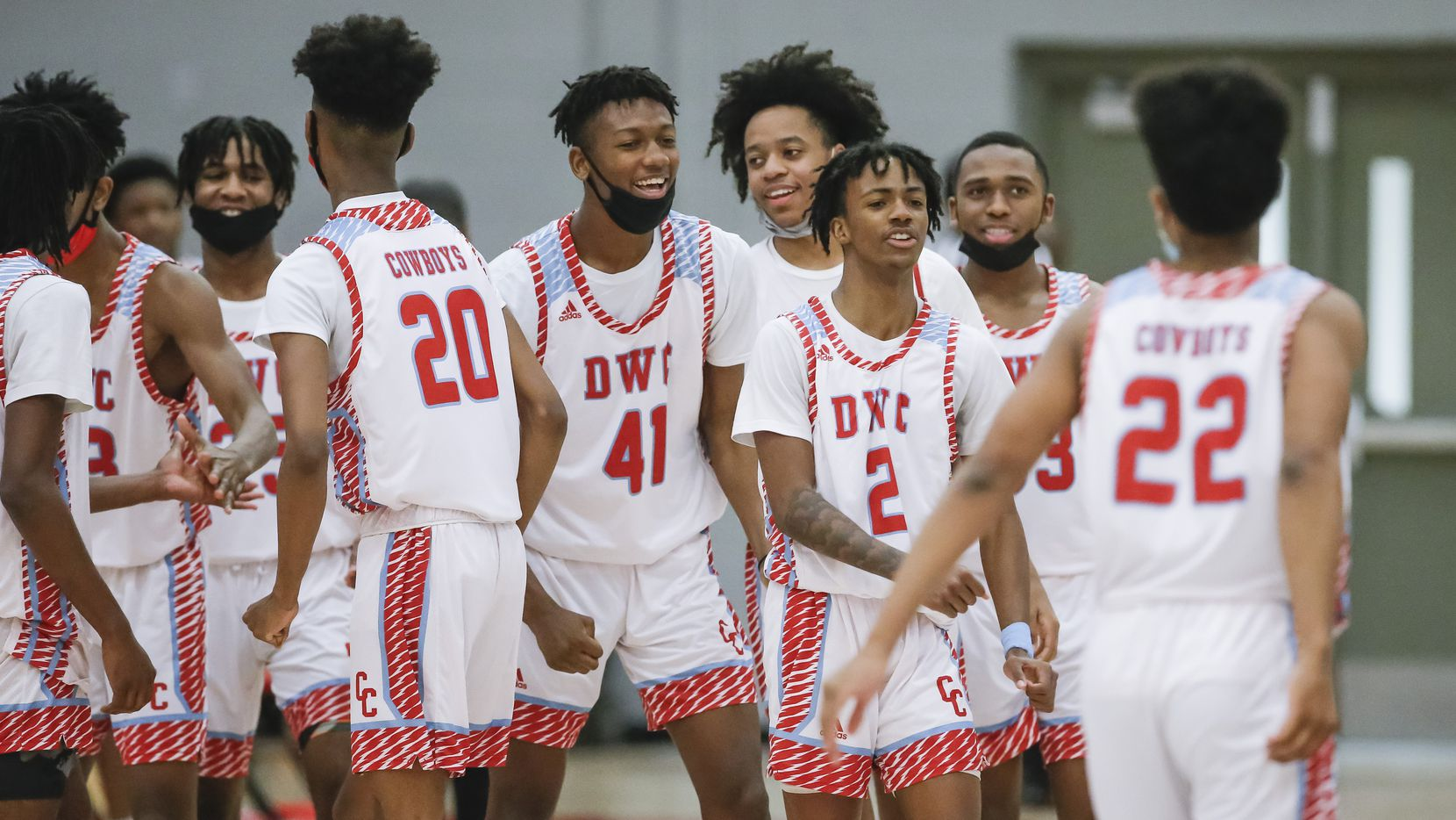 Carter celebrates a 73-58 win over Dallas Pinkston after a Class 4A regional quarterfinal boys basketball playoff game at Skyline High School in Dallas, Saturday, February 27, 2021.