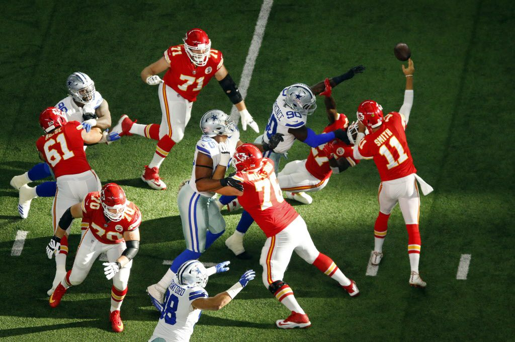 Dallas Cowboys defensive tackle David Irving (95) and defensive end Demarcus Lawrence (90) pressure Kansas City Chiefs quarterback Alex Smith (11) during the first quarter at AT&T Stadium in Arlington, Texas, Sunday, November 5, 2017. (Tom Fox/The Dallas Morning News)