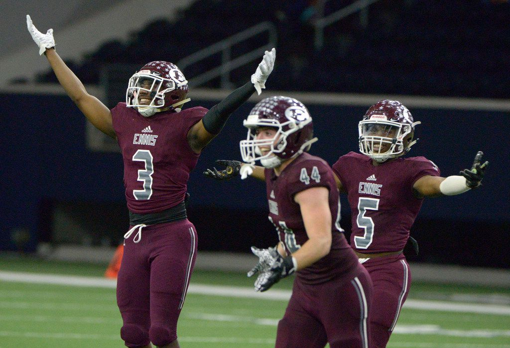 Ennis' De'vian Johnson (3) Dane Vernor (44) and Stephon Townsend (5) celebrate at the end of the Class 5A Division II Region  II semifinal high school football game between Frisco and Ennis, Friday, Nov. 29, 2019, in Frisco, Texas. Ennis won 17-0. (Matt Strasen/Special Contributor)