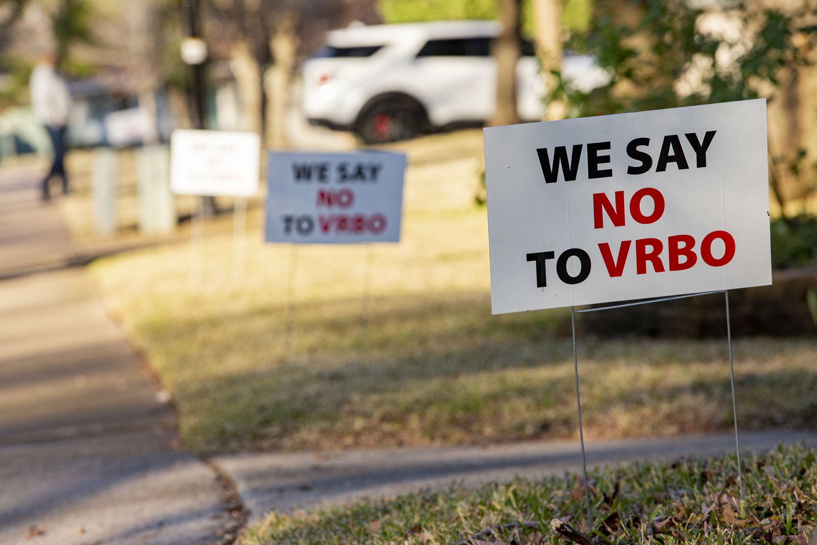"More than two dozen ""We say no to VRBO"" signs line the blocks surrounding a Lochwood property that went online in August as a short-term rental. The property owner converted it this month to a long-term rental and removed its listing from Airbnb and VRBO."