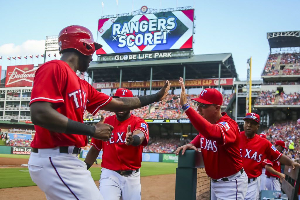 Texas Rangers second baseman Jurickson Profar celebrates with manager Jeff Banister after scoring a run during the first inning against the Pittsburgh Pirates at Globe Life Park on Saturday, May 28, 2016, in Arlington, Texas. (Smiley N. Pool/The Dallas Morning News)