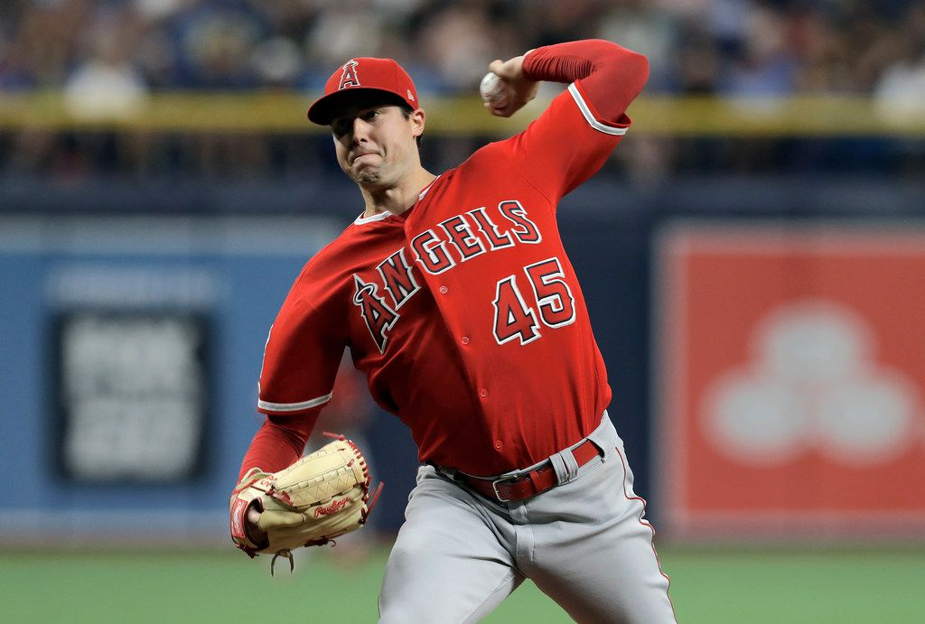 FILE - In this June 13, 2019 file photo Los Angeles Angels' Tyler Skaggs pitches to the Tampa Bay Rays during the first inning of a baseball game in St. Petersburg, Fla. Tyler Skaggs has died at age 27, Monday, July 1, 2019. Skaggs started the Angels' game Saturday night against the Athletics. Their game against the Texas Rangers on Monday night has been postponed. (AP Photo/Chris O'Meara, file)