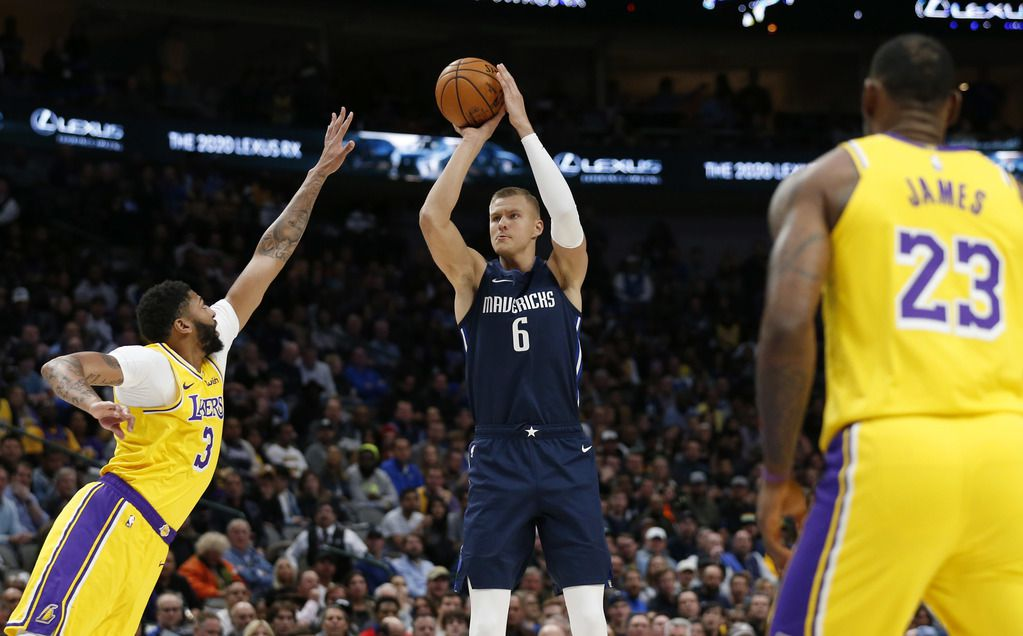 Dallas Mavericks forward Kristaps Porzingis (6) shoots over Los Angeles Lakers forward Anthony Davis (3) during the first quarter of play at American Airlines Center in Dallas on Friday, November 1, 2019. (Vernon Bryant/The Dallas Morning News)