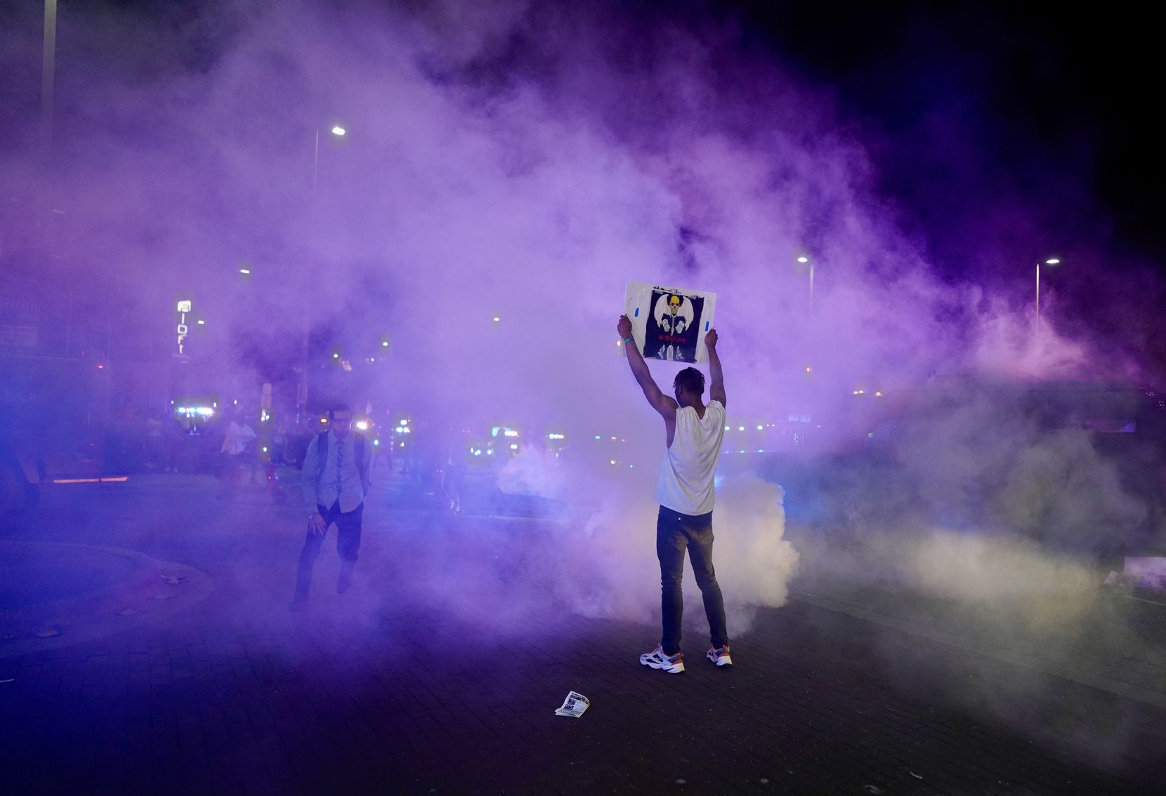 Protesters clash with Dallas police at Griffin and Young on Friday, May 29, 2020, in Dallas. The protest was organized by Next Generation Action Network in response to the in-custody death of George Floyd in Minneapolis.