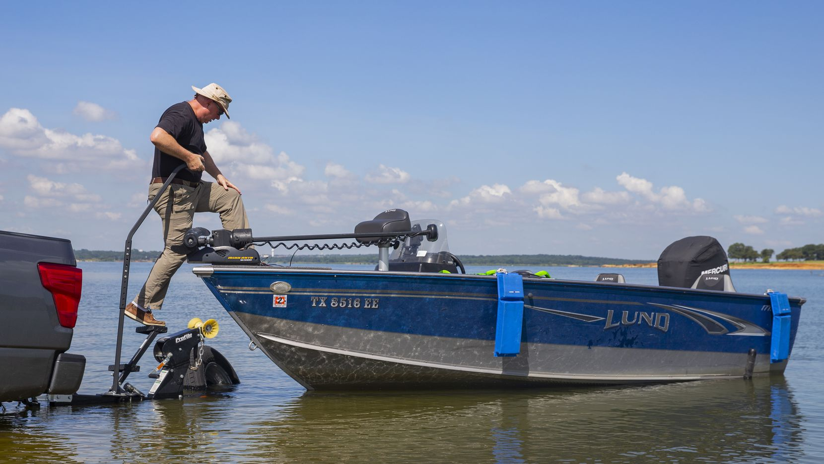 A man unloads his boat onto Grapevine Lake in this file photo. A number of boat ramps at the lake have been temporarily closed due to high water. (Juan Figueroa/ The Dallas Morning News)