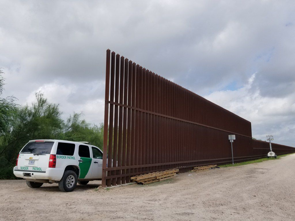 A Border Patrol vehicle and agent (not photographed) guard the levee road and border wall in Hidalgo, Texas, on Sunday Oct. 14, 2018, less than a mile from the Rio Grande. The wall ends here and resumes about eight miles down river.